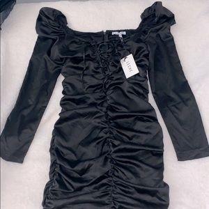 Beautiful black mini dress by Leche